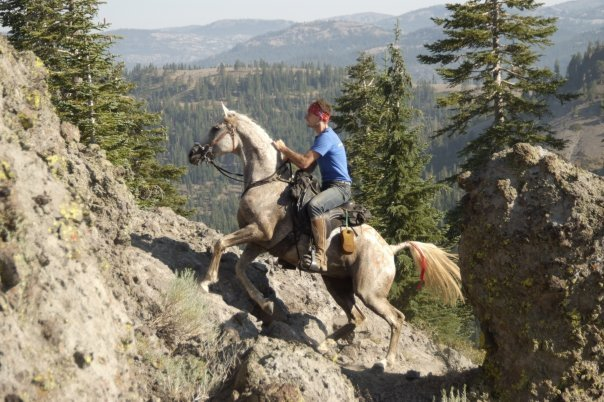 Duncan McLaughlin and Global Endurance Lady go over Cougar Rock in Easyboots