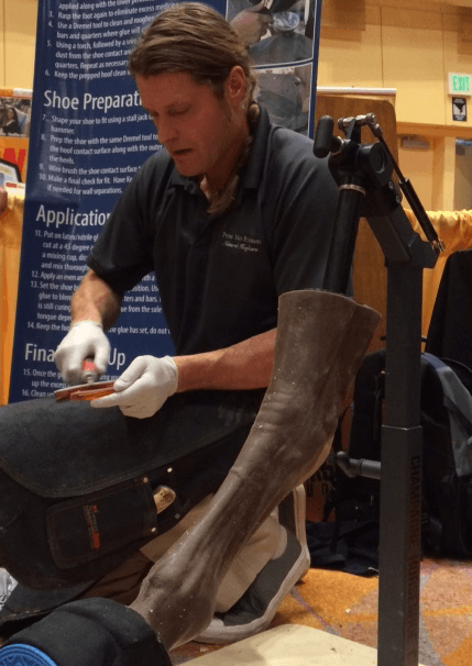 First Place Polyflex Division Pete Van Rossum prepping the sole side of the polyflex horseshoe